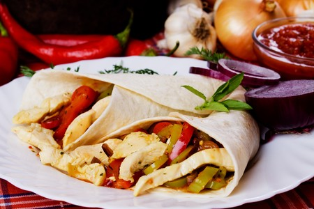 chicken meat: Trotilla wraps with chicken meat and grated vegetables Stock Photo
