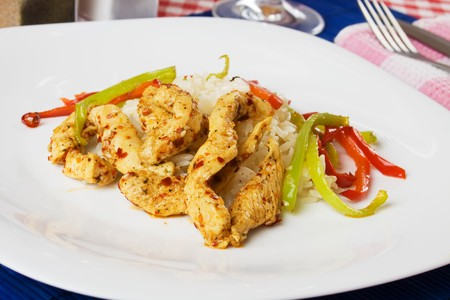chicken meat: Spicy asian chicken meat with rice and bell pepper Stock Photo