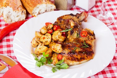 loin chops: Grilled pork loin chops with mushrooms and chili pepper