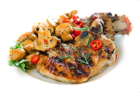 loin chops: Grilled pork loin chops with mushrooms isolated on white Stock Photo