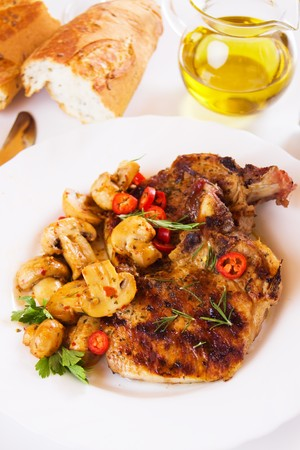 loin chops: Grilled pork loin chops with champignon mushrooms and chili pepper