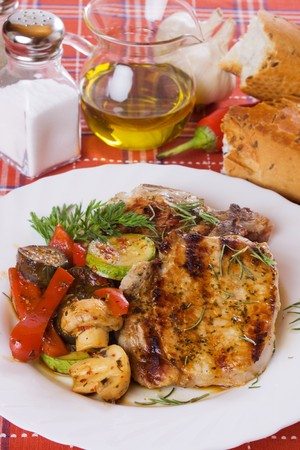loin chops: Grilled pork loin chops with mushrooms and vegetables