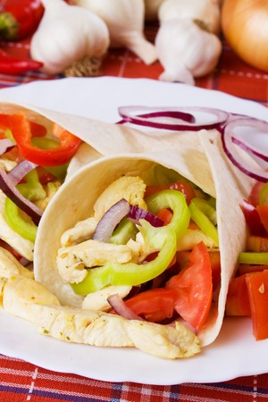 chicken meat: Tortilla wraps filled with chicken meat and vegetable salad