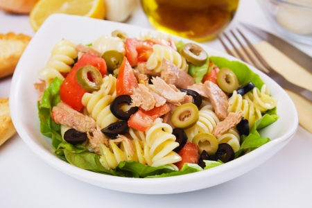 tuna: Classic tuna salad with pasta, olives and tomato Stock Photo