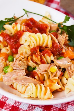 Healthy italian pasta with tuna meat and vegetables photo