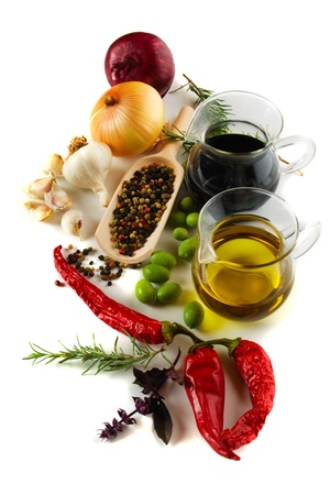 Olive oil and balsamic vinegar with mediterranean spices isolated on white photo