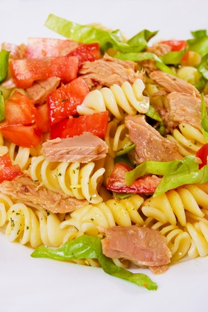 Pasta salad with tuna meat, tomato and lettuce photo