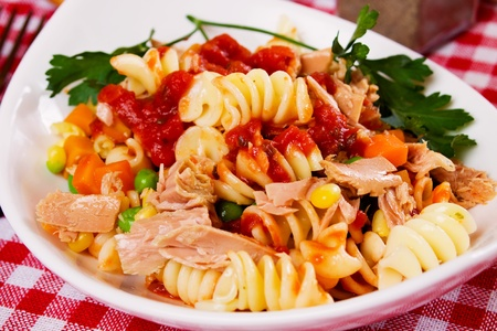 Tuna salad with pasta, vegetables and tomato sauce photo