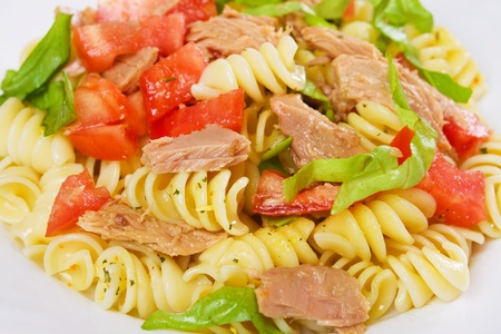 Tuna and pasta salad with lettuce and tomato photo