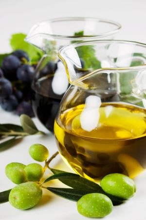 cooking oil: Extra virgin olive oil and balsamic vinegar on white background Stock Photo