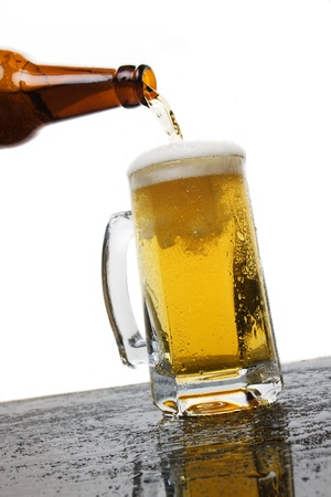 Mug of beer isolated on white background photo
