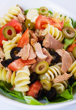 Tuna and pasta salad with tomato, lettuce and olives Stock Photo