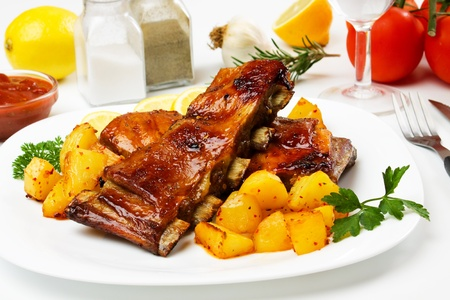 barbecued: Honey glazed barbecued ribs with baked potato Stock Photo