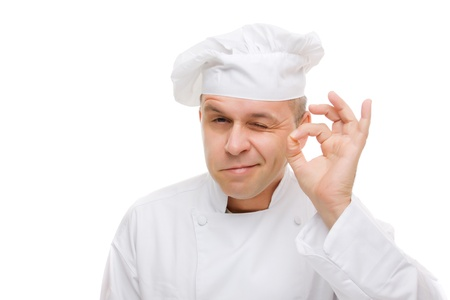 Chef showing ok hand sign isolated on white photo