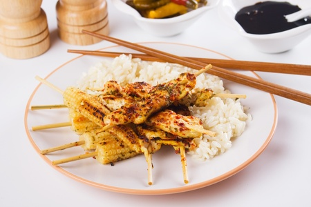 chicken meat: Grilled chicken meat and baby corn on skewer with cooked rice Stock Photo