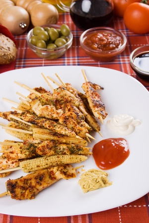 chicken meat: Spicy grilled chicken meat and baby corn skewer on white plate Stock Photo
