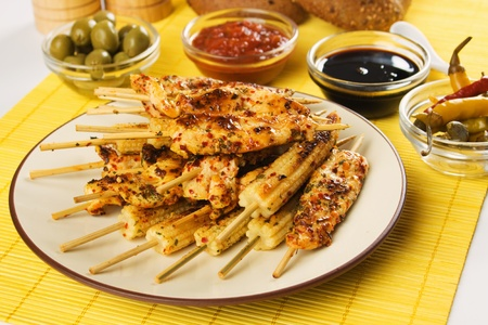 Asian style chicken and baby corn skewer served as party food