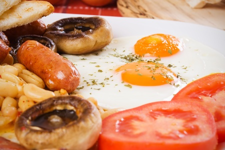 english breakfast: Fried eggs, beans, sausage and mushrooms, traditional english breakfast food