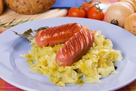german food: Fried sausage with sauerkraut, traditional german meal