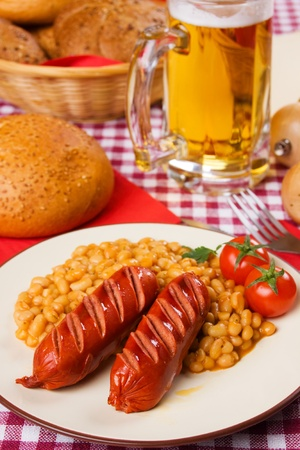 Grilled sausage with white bean, traditional european meal photo