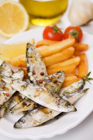 Grilled sardine fish served with french fries and cherry tomato Stock Photo - 8930636