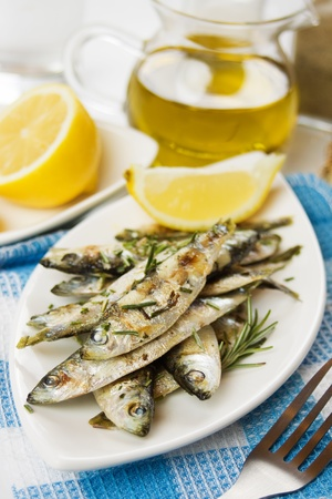 Grilled sardine fish served with rosemary and lemon photo