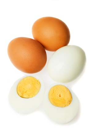 Hard boiled chicken eggs isolated on white background