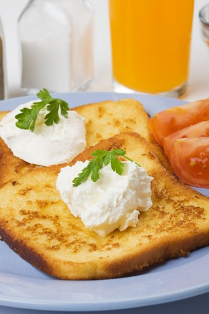French toast with sour cream served on a plate Stock Photo - 9139722