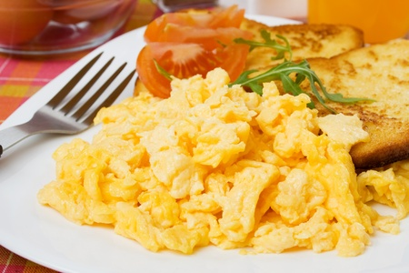scrambled: Scrambled egg served with french toast and tomato