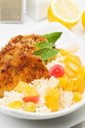 Carribean style pork loin chops with rice and tropical fruit photo