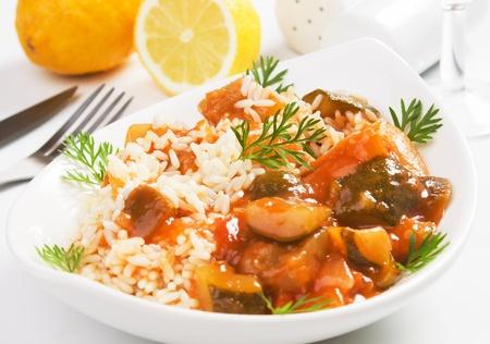 vegan food: Vegetables and rice in sauce, healthy vegetarian meal Stock Photo