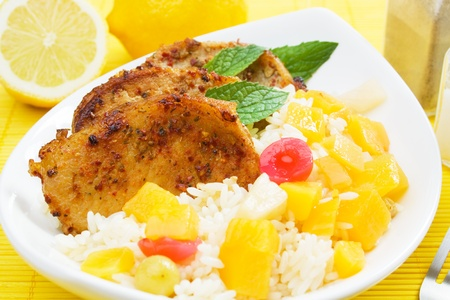Carribean style pork loin chops with tropisal fruit and cooked rice photo
