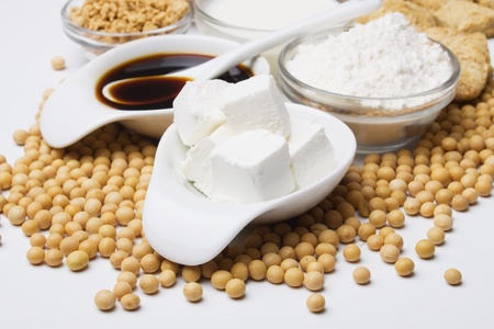 soya bean: tofu, soya sauce and other soy products over white background, not isolated