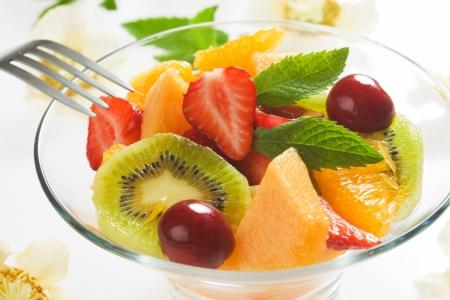 Fruit salad with kiwi, strawberry, orange, cherry and melon