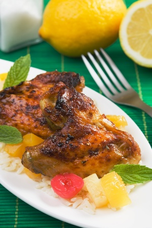 chicken rice: Caribbean style grilled chicken wings with rice and tropical fruit