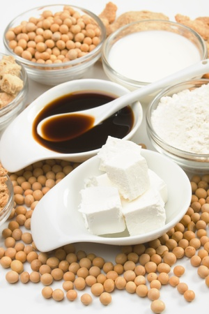 Tofu, soy-sauce and other soy products over white background
