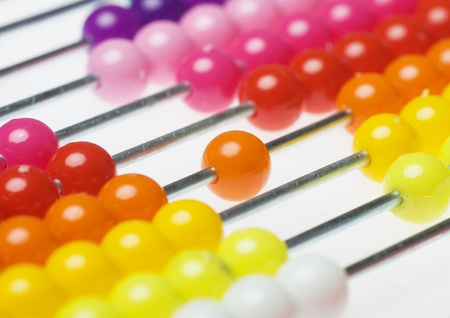 Colorful abacus beads over white background, not isolated photo