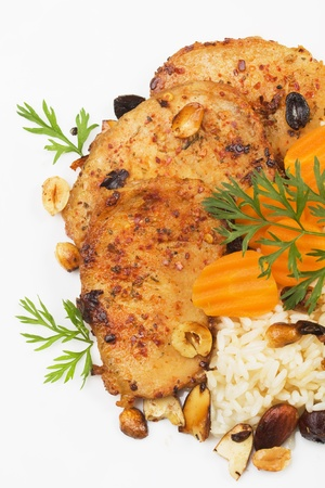 loin chops: Spicy pork loin chops with roasted nuts, cooked rice and vegetables