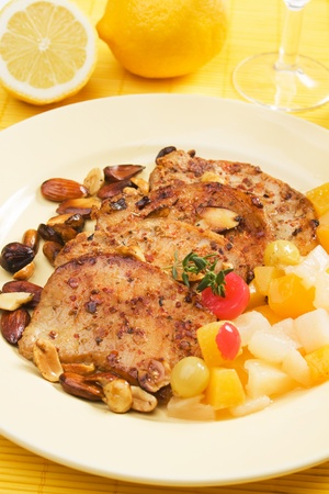 caribbean food: Slices of spicy steak with roasted nuts and tropical fruit