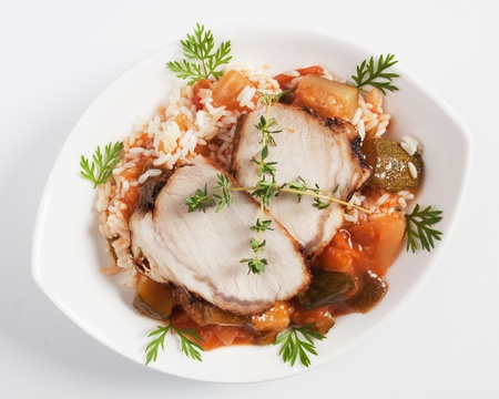 loin chops: Slices of roasted pork loin chops with rice and vegetables Stock Photo