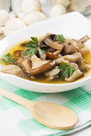 mushroom soup: Clear soup with five kinds of mushroom in white bowl Stock Photo