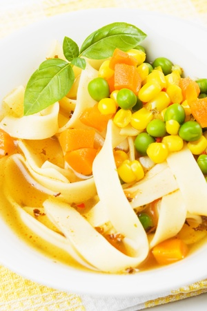 noodle soup: Vegetable and noodle soup with green peas, carrot and corn
