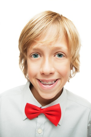 Smiling blonde boy with tooth brace isolated on white photo