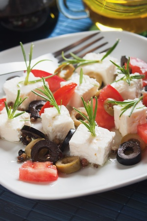 Feta cheese salad with rosemary, tomato and olive photo