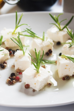 italian cusine: Feta cheese salad with rosemary, peppercorn and olive oil