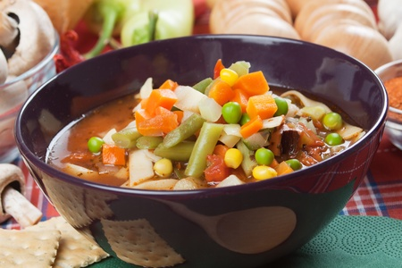 minestrone: Healthy minestrone soup with carrot, peas, corn and other vegetables