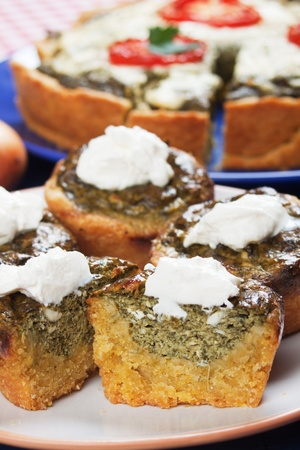 pone: Spinach quiche with cream on a plate, selective focus