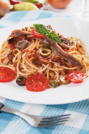 puttanesca: Spaghetti a la puttanesca with caper, anchovy and olives