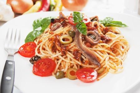 Spaghetti a la puttanesca with caper, anchovy and olives