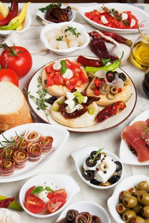 Antipasto, tapas, various appetizer food traditional in meditarranean countries Standard-Bild